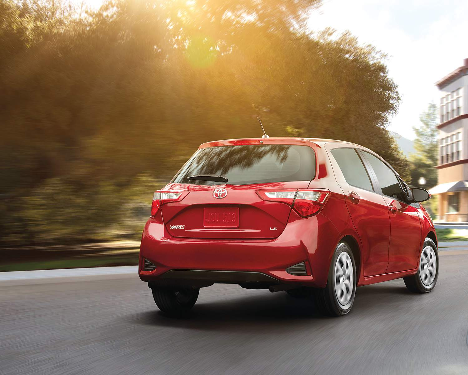 toyota-2018-yaris-hatchback-exterior-absolutely-red-rear-l